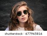 female in dark glasses... | Shutterstock . vector #677965816
