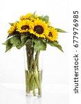 Bright Sunflowers In Glass Vas...