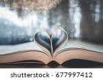 book of love heart shaped at... | Shutterstock . vector #677997412
