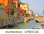 colorful bridge across canal in ...