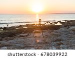camera with tripod over sun... | Shutterstock . vector #678039922
