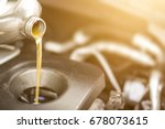 pouring oil to car engine.... | Shutterstock . vector #678073615