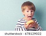 little cute boy in striped... | Shutterstock . vector #678129022
