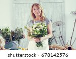 florists woman working at... | Shutterstock . vector #678142576