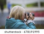 Senior Woman With Photo Camera...