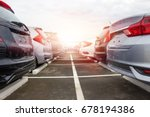 a row of new cars parked at a...