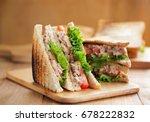 tuna sandwich on wooden board
