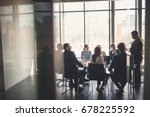 Stock photo business people working in conference room 678225592