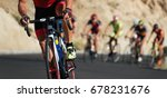 Small photo of Cycling competition,cyclist athletes riding a race,climbing up a hill on a bicycle
