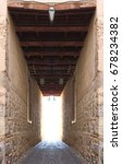 Small photo of Surreal and Symmetrical photographs of Famous Medieval Shed, passageway, in the street of Toledo, Spain, The tunnel after death, the passage to the light at the end of the tunnel, post mortem visions