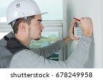 worker installing alarm system... | Shutterstock . vector #678249958