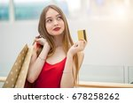 Woman Holding Credit Card ...