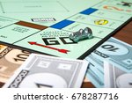 Small photo of CALDWELL, IDAHO/USA - MARCH 16, 2015: Car pulling around Go to collect 200 bucks in Monopoly