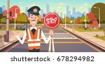 guard with stop sign on road... | Shutterstock .eps vector #678294982