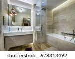 Modern bathroom with wooden floor in stylish apartment - stock photo