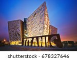 Small photo of BELFAST, NORTHERN IRELAND - JUNE 28, 2017: Sunset over Titanic Belfast - museum, touristic attraction and monument to Belfast's maritime heritage on the site of the former Harland and Wolff shipyard.
