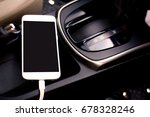 phone on the dashboard in the... | Shutterstock . vector #678328246