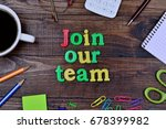 Small photo of The words Join our team on wooden table