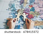 hands holding wooden little men ... | Shutterstock . vector #678415372