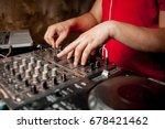 the dj's hand on the dj mixer.... | Shutterstock . vector #678421462