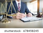 lawyer hand writes the document ...   Shutterstock . vector #678458245