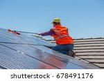 young worker cleaning solar... | Shutterstock . vector #678491176