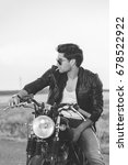 biker man sits on a bike | Shutterstock . vector #678522922