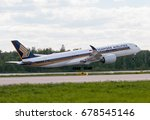 Small photo of Moscow, Domodedovo International Airport, Russia - May 30, 2011: Airbus Airbus A350-941 9V-SME Singapore airlines takeoff at Domodedovo International Airport