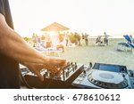 dj mixing at sunset beach party ... | Shutterstock . vector #678610612