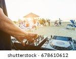 dj mixing at sunset beach party ... | Shutterstock . vector #678610612