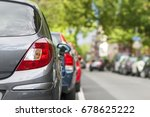 rows of cars parked on the... | Shutterstock . vector #678625222