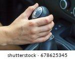 Female driver hand shifting gear manually. Girl driving a car - stock photo