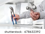 Hands With Faucet And Pipe...
