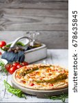 hot homemade pizza with... | Shutterstock . vector #678635845