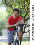 young man sit on bike in wood... | Shutterstock . vector #678674266