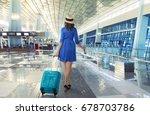 young asian traveler wearing...   Shutterstock . vector #678703786