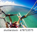View Of Couple Parasailing Wit...
