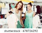happy adult customers looking... | Shutterstock . vector #678726292