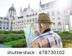 senior tourist man in hat... | Shutterstock . vector #678730102