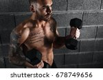 muscular man working out in gym ...   Shutterstock . vector #678749656