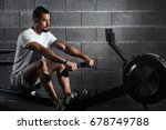fitness young man using rowing... | Shutterstock . vector #678749788