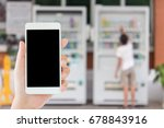 Small photo of woman use mobile phone and blurred image of a boy uses vending machine
