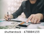 business man doing finances on...   Shutterstock . vector #678884155