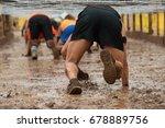 mud race runners.crawling...   Shutterstock . vector #678889756