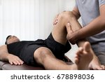therapist treating injured knee ... | Shutterstock . vector #678898036