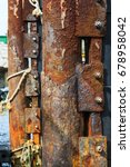 Rusty Mooring Post On The Pier...