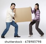 couple carrying a box together | Shutterstock . vector #678985798