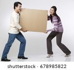 couple carrying a box   Shutterstock . vector #678985822