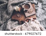 cup of coffee and candle on... | Shutterstock . vector #679027672