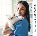 beautiful young veterinarian is ... | Shutterstock . vector #679043356